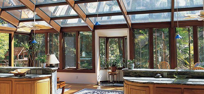 Four seasons room provide a beautiful living space year round with sturdy architectural glazing