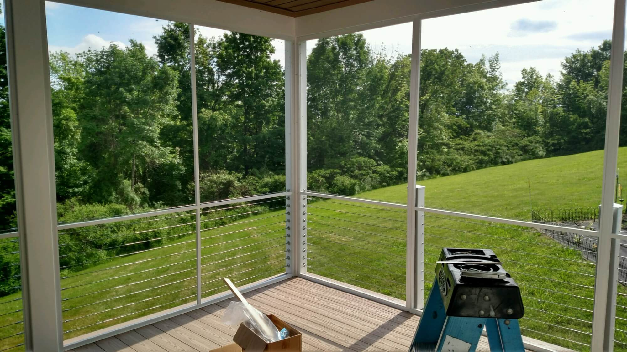 Beautiful screened porch with wire rails overlooking a sunny back yard - Modern Glazing
