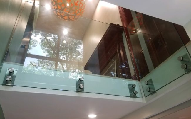 Architectural glass railings gives the space and elegant and modern feel
